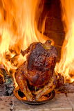 Hen a grill. Hen a grill against a fireplace flame. A celebratory supper Stock Images
