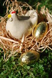 Hen lays golden eggs Royalty Free Stock Photography