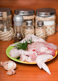 Hen lies on a chopping board. Stock Image