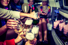 Hen-party with champagne. Girls in limo at hen-party stock images