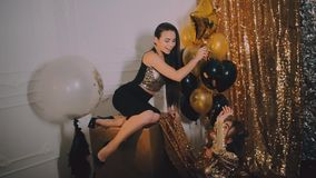 Hen-party. Two girls are having fun. Girl blowing confetti stock video