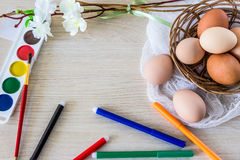 Hen`s eggs is prepared for painting with paints gouache and food markers for Easter. Royalty Free Stock Photography