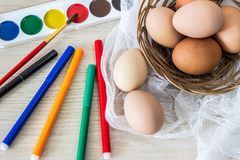 Hen`s eggs is prepared for painting with paints gouache and food markers for Easter. Stock Photography
