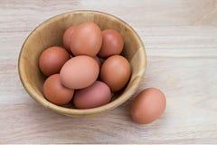 Hen's eggs in wooden bowl Stock Image