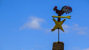 Hen-shaped weather vane. Hen-shaped weather vane on blue sky background Royalty Free Stock Photography
