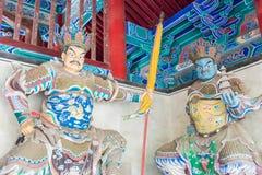 HENAN KINA - November 09 2015: Budda statyer på den Shaolin templet (Worl Arkivbilder