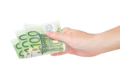 Hand holding euro banknotes. Female hand holding some euro banknotes isolated on white with clipping path Stock Photo