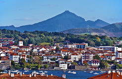 Hendaye cityscape. Cityscape of French border town Hendaye, as seen from Spanish Hondarribia, with Famous Rhune Mount at Background, Basque country, Province of Royalty Free Stock Photography