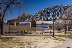 Henderson Railroad Bridge - Ohio River, Kentucky & Indiana. A sunny afternoon view of a mammoth railroad Warren through truss bridge over the Ohio River between royalty free stock images