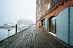 Henderson`s Wharf, on a foggy day in Fells Point, Baltimore, Maryland.  royalty free stock photography