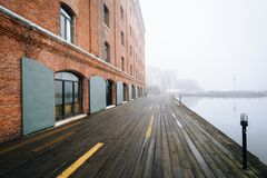 Henderson`s Wharf, on a foggy day in Fells Point, Baltimore, Maryland.  royalty free stock photos