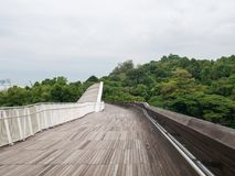 Henderson Waves Bridge Singapore Pedestrian Bridge. Henderson Waves Bridge with Undulating Curved Steel and Curved Wood Floor, is the highest pedestrian bridge Royalty Free Stock Images