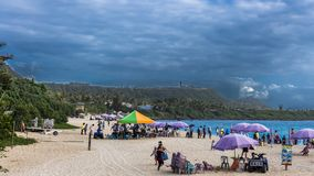 Crowded Baisha beach with mainland China tourist stock images