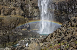 Hengifoss is the second highest waterfall on Iceland. The most s. Rainbow over the flow of a waterfall  Hengifoss is the second highest waterfall on Iceland Stock Photography
