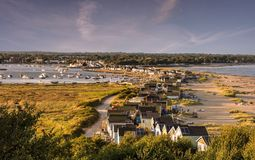 Hengistbury Head beach huts bathed in the evening summer sun Royalty Free Stock Photography