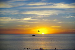 Henley Silhouettes, Adelaide. Photograph taken at sunset from Henley Beach looking towards the Gulf St Vincent, featuring numerous people at the water's edge, a stock photos
