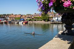 Skyline Of Henley On Thames In Oxfordshire UK With Rower On Rive stock photography
