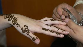 Henna. A woman having henna done on her hand Stock Photography
