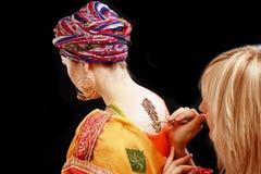 Henna applying on the back Royalty Free Stock Photos