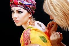 Henna applying on the back Stock Image