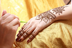 Henna applying Stock Images