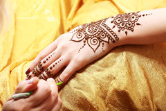 Henna applying Stock Photo