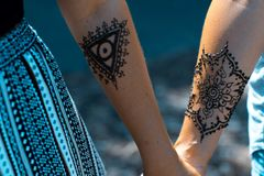 Henna arm art. Tribal Henna art designs on arm at vintage pop up markets royalty free stock photo