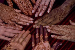 Henna art on hands. A close up view of elaborate henna body art on several pairs of hands stock photos