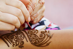 Henna art on woman's hand. The Indian pattern is drawn a girl. Mehandi Royalty Free Stock Photography