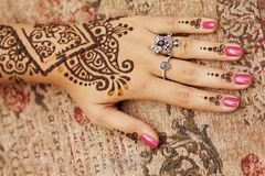 Henna art on woman's hand. The Indian pattern is drawn a girl. Mehandi Royalty Free Stock Photos
