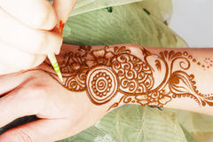 Henna being applied Stock Images