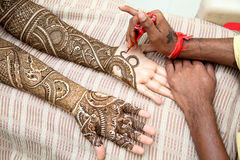 Henna being applied to bride's hand Stock Images