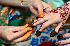 Henna being applied to hand Stock Photos