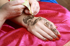 Henna being applied to hand Stock Image