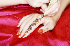 Henna being applied to hand Royalty Free Stock Photos