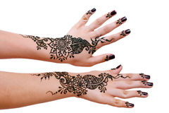 Henna being applied to hands Royalty Free Stock Images
