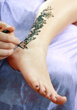 Henna being applied to leg Stock Photos