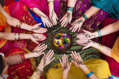 Henna Decorated Hands Arranged in a Circle. Six pairs of henna decorated female hands arranged in a circle on a colorful background Stock Photo