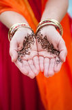 Henna Decorated Palms in a Gesture of Charity Royalty Free Stock Image