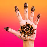 Henna design on the palm of the hand  colour gradient Royalty Free Stock Images