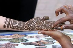 Henna designing on female hand Royalty Free Stock Image