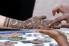 Henna designing on female hand royalty free stock image