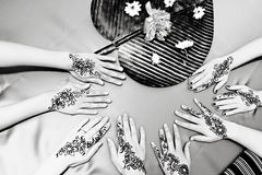 Henna Designs. Four pairs of hands with traditional henna deisgns stock images
