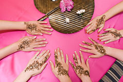 Henna Designs. Four pairs of hands with traditional henna deisgns royalty free stock photo