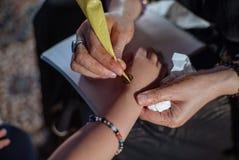 Henna. A detailed shot of an artist making henna art Royalty Free Stock Photo