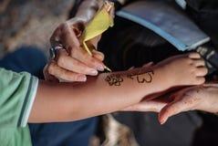Henna. A detailed shot of an artist making henna art Stock Photography