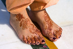 Henna on feet of bride Stock Photos