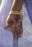 Henna Hand. A beautiful henna tatooed hand against a lavender sari Stock Photography