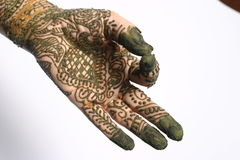 Henna on hand. Young woman hands painted with henna in traditional design Stock Photography