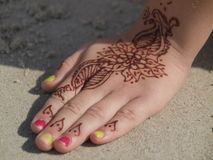 Henna hand drawing. Colorful photo of girls hand Stock Photography